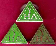 THREE OLD YOUTH HOSTEL ASSOCIATION BADGES.