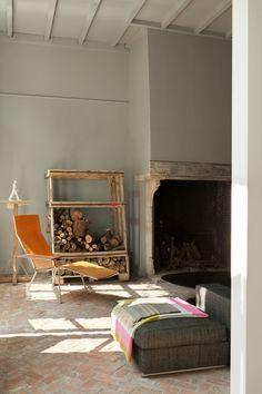 A Maarten Van Severen leather lounge chair in the living room.