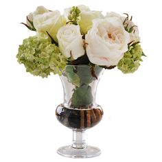 Faux rose arrangement in a footed glass vase.  Product: Faux floral arrangementConstruction Material: Silk and g...