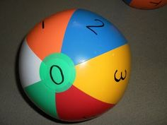 Write numbers on beach ball, game = good ideas for letter and number reviews