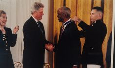 John Hope Franklin being awarded a medal from President Bill Clinton, September 29, 1995. Official White House Photograph.