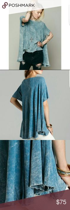 Free people circle in the sand Washed teal color . Raw hem lines . Size m/L. Excellent condition. Free People Tops Tees - Short Sleeve