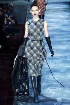 Why don't you try a little severe sexiness by way of embellished tonal plaid separates with matching accessories and glossy boots? And why don't you finish it all off with a high, tight top knot and a fur stole that's to die for?    - HarpersBAZAAR.com
