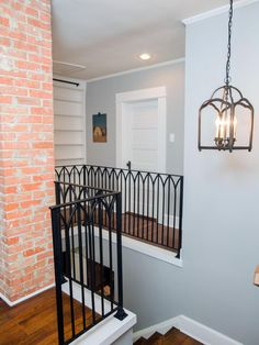 The style of the metal railing used on the front stair is repeated on the second floor landing.