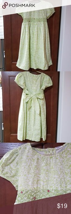 April Cornell girls green Farm print dress 5/6 This is an adorable April Cornell girls dress. The style name is farmyard little girl in green. It is a light apple green. It has smoking at the waist on the front of the dress with little pink bouillons embroidered on smoking.  It has a nice tie waist in the back. There is a little gather detail on the shoulders to create a little bubble effect it has buttons all the way down the back that are functioning from top to bottom. It is 100% cotton…