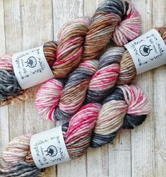 Love Letters - gray, black, browns, and pink YAY! SINGLES BULKY/SUPER BULKY - This is a singles yarn that is spun from a soft 80% superwash merino and 20% nylon. You will love the wonderful drape of the fabric it creates. This base is great for sweaters, hats, mittens and anything else