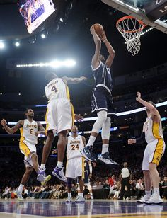 Kevin Durant #35 of the Oklahoma City Thunder dunks between Antawn Jamison #4 and Pau Gasol #16 of the Los Angeles Lakers during a 106-95 Laker win at Staples Center on January 27, 2013 in Los Angeles, California.