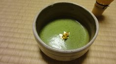 "This is Matcha powdered green tea with ""Kinpaku"", GOLD!!! (Gold Leaf Made in JAPAN). We serve it for thin tea and thick tea at Chanoyu Class. http://www.japancultureagency.com/en_japan_culture_03.html"
