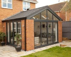 Solid roof sunrooms from Wessex Windows in Winchester come in various styles, colours and finishes. Get your free quote today! Solid roof sunrooms from Wessex Windows in Winchester come in various styles, colours and finishes. Get your free quote today! House Extension Plans, House Extension Design, Glass Extension, Extension Ideas, Extension Google, Brick Extension, Rear Extension, Orangerie Extension, Conservatory Extension