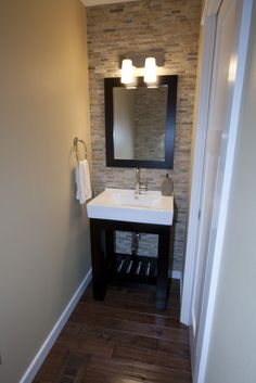 Love this for small guest powder room, love the wood floors, stone, warm beige paint color with the crisp white!