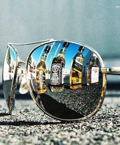 the two loves of my life.. sunglasses and whiskey <3