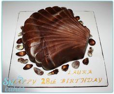 A Guylian chocolate fan's dream cake! A chocolate cake shaped like a Guylian Seashell, with crushed Guylian chocolates in the filling! [SNCakes.com]