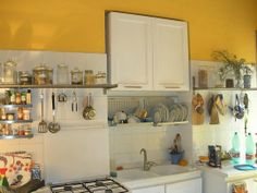 Small #kitchens, love the cheery but not obnoxious yellow.