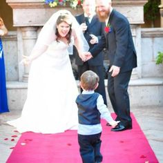 Adorable ring bearer running down the aisle to joyous bride and groom | Randi Pond Photography | villasiena.cc