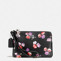 Coach Corner Zip Wristlet Wildflower Print NWT; Brand new w/ tags! Style #: F65188 Purple, red, & white wildflowers print on black.  Coated canvas with zip closure and attached wrist strap. Two credit card pockets. Measures: 6.25 inch width & 4 inch height. Discounts available on bundles! Please ask any Q's before you buy so that you may make an informed purchase. I try to describe all items as accurately as possible & strive to provide only 5 star service! No Paypal, No trades! Bundles…