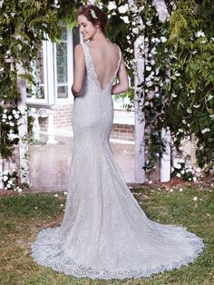 Rebecca Ingram - LAUREN, Romantic lace appliqués cascade over tulle and Inessa Jersey in this classic fit-and-flare wedding dress, with sheer illusion lace comprising the straps, V-neckline, and plunging V-back. Finished with zipper closure.