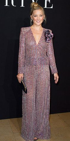 Last Night's Look: Love It or Leave It?   KATE HUDSON   The Style team is divided on Kate's dazzling deep-V Armani Privé jumpsuit, her blooming brooch and her Leaning Tower of Topknot at the brand's show in Paris, so we need you to weigh in and make the final call.
