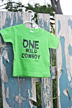 ONE WILD COWBOY INFANT/TODDLER SHIRT – Busy Bicycle FIRST BIRTHDAY PARTY COWBOY GOWGIRL COLORS FUN CELEBRATE WESTERN WEST SOUTHERN SOUTH QUOTE BOY GIRL PARTIES