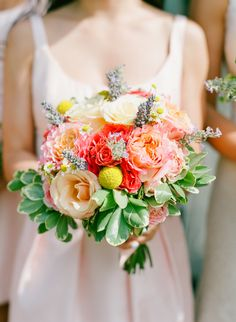 Colorful peach and coral bouquet: http://www.stylemepretty.com/2016/07/14/forget-catching-pokemon-catch-these-wedding-bouquets-instead/