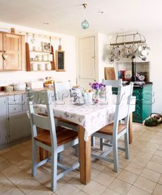 Blue painted chairs at kitchen table in Oxfo Painted Kitchen Tables, Painted Chairs, Cottages England, Interior Photography, Table And Chairs, Interiors, Blue, Furniture, Ideas