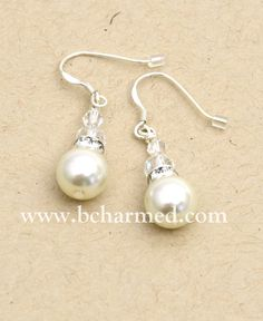 """These earrings have been a best-selling design in my shop for years. The idea behind this design was to offer a stylish twist on the classic pearl studs, something a bit longer and with a little sparkle, which brings luminosity to a woman's face. They are the perfect match for this year's trendy lacy tops and the white pearls have made them a favorite of brides for years. They also are a timeless staple that every woman needs in her jewelry box.""~ Noriane   www.bcharmed.com"