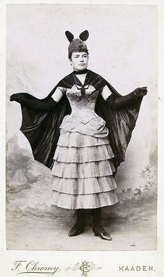 Victorian Bat Woman costume c. 1880's Look - put on animal ears and wear a sexy outfit has been a Halloween staple for over a century!