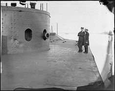 In this picture, the deck of the U.S.S. Monitor can be seen along with one of its many turrets. Despite the fact that the photographer and people in the picture remain unidentified, it was taken on July 9, 1862 after the Battle of the Ironclads, in which the U.S.S. Merrimack (later the U.S.S. Virginia) fought the U.S.S. Monitor. Despite having no clear victor, the battle exemplified important changes in military technology in terms of sophistication and the ability to withstand attacks.