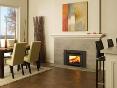 Regency inserts and woodstoves come in different sizes producing from 55,000 to 80,000 BTUs of toasty warmth for a single area up to an entire home. Because of their high efficiency, they warm up a room quickly meeting the air quality standards set by the Environmental Protection Agency and Washington State's low emissions standards.