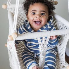 Gorgeous Adelisa & Co. handmade, macramé baby swing. Our macramé baby hammock swings are handmade in Nicaragua by talented artisans. With beautifully crafted wooden bars and cream coloured cotton, these Adelisa & Co. macramé baby swings are the perfect neutral baby item for your home. Whether it's for a playroom, nursery, or living room- this swing will fit beautifully with any type of décor. This baby and toddler swing can also be used outdoors.