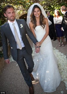 Big day: lily Aldridge wore a strapless white Vera Wang dress with layers of Chantilly lace and corded lace appliqué as she married Caleb Fo...
