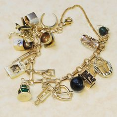 This Vintage 1930s - 1940s 14k Yellow Gold (18) Charm Bracelet is just the cats meow! It is so cute with such a variety of charms this will