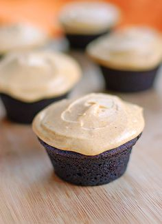 chocolate muffins with pumpkin cream cheese frosting.