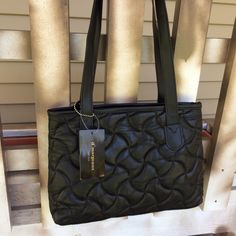 """NWT Genuine Leather Black Quilted Shoulder Bag Brand new with tags. Retail $44. Genuine leather. Measures 12"""" wide at opening, 9"""" tall x 3.5"""" deep. Strap drop 12."""" Bags Shoulder Bags"""