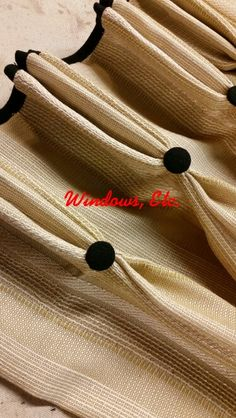 More added details, contrast border at the top of these pinch pleated curtains and buttons at the pleats. Www.windowsetcdrapery.com