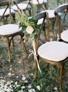 Floral-topped ceremony chairs: http://www.stylemepretty.com/2016/03/07/whimsical-ranch-wedding-in-texas/ | Photography: Sarah Kate - http://sarahkatephoto.com/