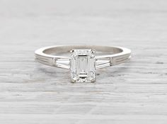 Antique Art Deco Tiffany & Co. engagement ring made in platinum and centered with a GIA certified 1.13 carat emerald cut diamond with H color and VS1 clarity. Signed Tiffany & Co. Circa 1920.