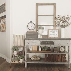 I like the idea of an old window turned into a hallway/entryway mirror