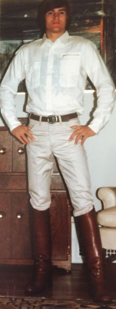 Young man in white jeans and tall boots