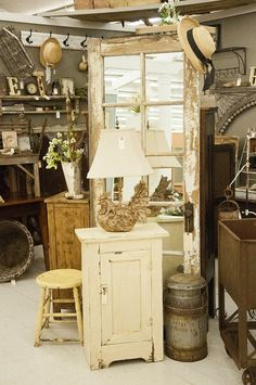 Beautiful booth - mostly neutrals; distressed pieces; interesting layout