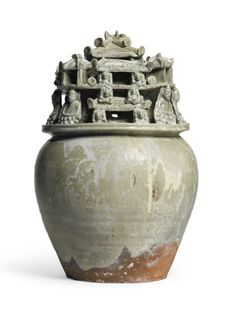 A 'YUE' CELADON-GLAZED FUNERARY JAR WITH SEATED BUDDHIST FIGURES<br>WESTERN JIN DYNASTY | Lot | Sotheby's