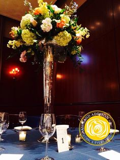 Wedding Table centerpieces at the Newberry Library in Chicago by AshAddEvents   Mercury trumpet vases filled with hydrangea, pink and pale yellow stock flower, delphinium, roses and hypericum.  Wedding centerpieces elegant wedding ideas chicago weddings