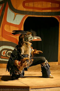 Raven costume, Chilkat Dancers' Storytelling Theater Show, Haines, Alaska. Bringing ancient legends to the stage in pantomime expression using carved masks and traditional costumes.