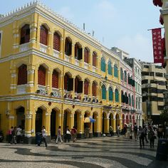 Brightly painted buildings are a reminder of the old Portuguese control of Macau, China.
