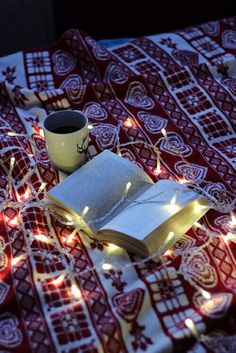 Image via We Heart It https://weheartit.com/entry/148952126 #blanket #book #chill #christmas #christmaslights #cozy #reading #hotcoffee #winternight #lazynight