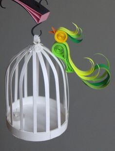 Quilling by Suzanne Ilic --- was going to buy a cage for a Paris-themed room. But, now, I think not :). Quilling (a whole piece of art on its own) will look GREAT
