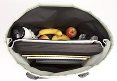 The inside of a Healthy Tote.  Divided to keep food and snacks separate from papers and laptop.  No more papers ruined by sweaty water bottles!