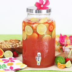Summer is the perfect time for a Luau party. Whether you are celebrating at the beach or by the pool, this delicious tropical cocktail recipe the perfect party punch to please a cr