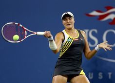 Nadia Petrova of Russia returns a shot to Maria Sharapova of Russia during Day Seven of the 2012 US Open