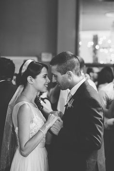 A stolen moment at the reception between the bride and groom