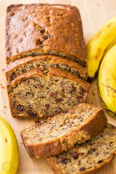 This Banana Bread Recipe is loaded with ripe bananas, tangy sweet raisins and toasted walnuts making it a banana nut bread. One of our favorite ripe banana recipes and even better with overripe bananas! This banana nut bread is super moist, easy and makes a great breakfast on-the-go.